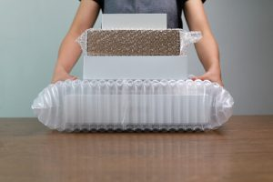 Packing produk yang berlapis dan pakai bubble wrap